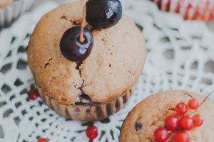 sweet homemade muffins stuffed with cherries and red currant