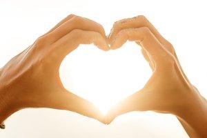 Woman hands show heart sign.