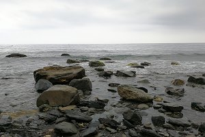 Beach with big stones on a misty day