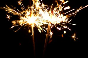 Burning Sparklers. Christmas and New Year lights.