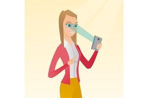 Woman using iris scanner to unlock mobile phone.