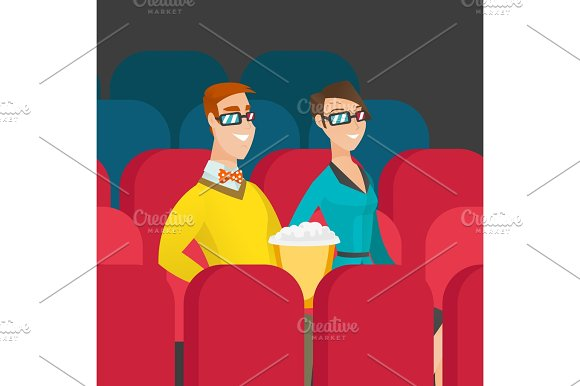 Caucasian Couple Watching 3D Movie In The Theatre
