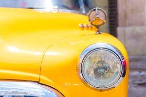 Closeup of yellow classic vintage car in Old Havana, Cuba