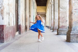 Adorable little girl in the street in Old Havana, Cuba. Cute kid have fun in old street of the city