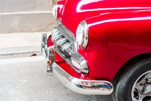 Closeup of red classic vintage car in Old Havana, Cuba