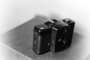 Black and white vintage camera vignette bokeh background
