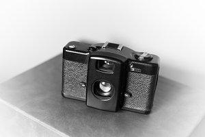 Black and white vintage camera vignette bokeh background