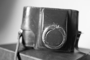 Black and white vintage camera case bokeh background