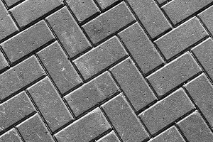 Horizontal vivid black and white street pavement textured backgr