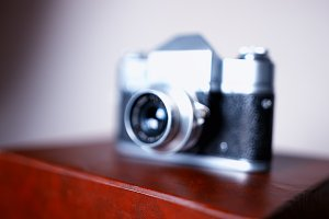 Vintage rangefinder camera bokeh background