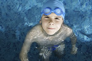 Child swimmer in swimming pool