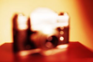 Vintage camera orange bokeh blurred background