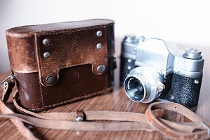 Vintage rangefinder camera with leather cover case background