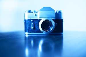 Horizontal vintage blue rangefinder camera background