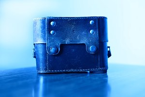 Horizontal blue vintage camera case background