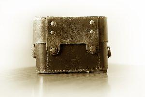 Vintage leather camera case background