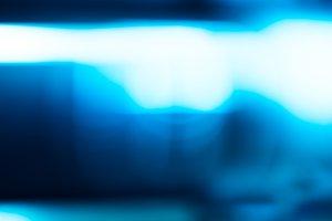 Horizontal blue glowing bokeh background