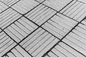 Horizontal black ad white diagonal city tile background backdrop