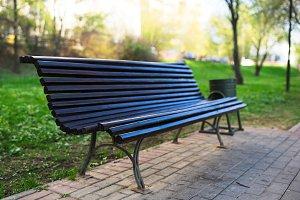 Diagonal park bench bokeh background with light leak