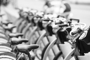 Black and white perspective bicycle row bokeh background