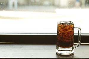 iced cola glass on the table