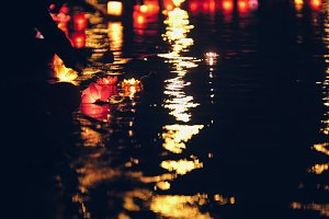 Blurres nackground - floating lighting water Lanterns on river at night