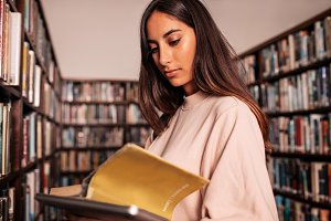University student reading book