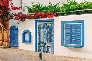 Facade of small white house, Greece