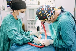 Surgeons Operating in the Hospital.