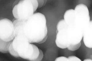 Horizontal black and white bokeh blobs background backdrop