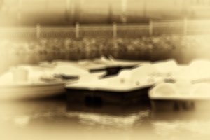 Horizntal sepia antique blurred boats in park fence background b