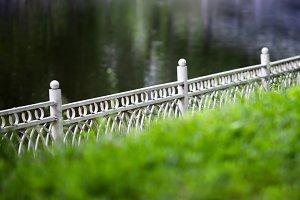 Horizontal diagonal fence in park bokeh background backdrop