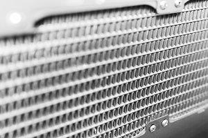 Diagonal black and white grid bokeh background