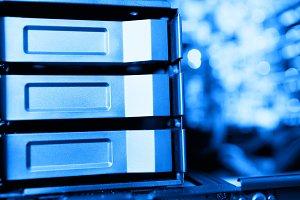 Horizontal blue data storage array bokeh background