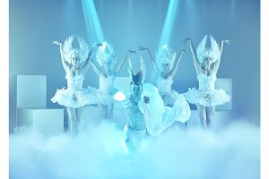 The studio shot of group of modern dancers on blue background