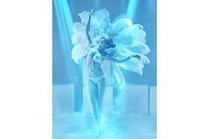The studio shot of female modern dancer on blue background