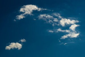 Horizontal dramatic bright day cloudscape background backdrop