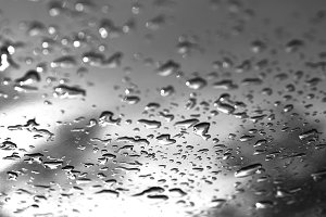 Black and white water drops after rain bokeh background