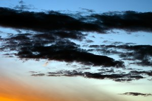 Horizontal vibrant dramatic sunset cloudscape background backdro