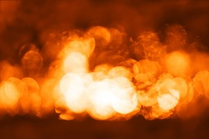 Horizontal dramatic orange bokeh background