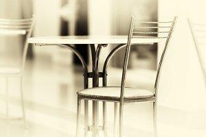 Horizontal sepia vintage business chairs bokeh background