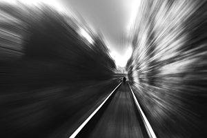 Black and white man on railway motion blur background