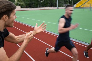 Trainer screaming near young multiethnic athlete men