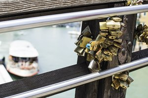 Padlocks of lovers placed on the bri