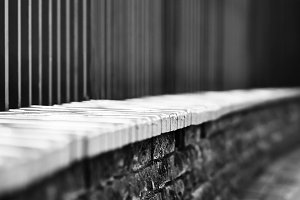 Horizontal black and white dramatic fence bokeh background