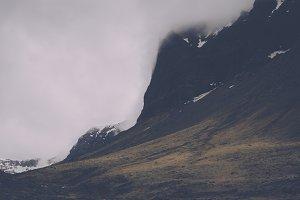 Dark Mountain Landscape in Clouds
