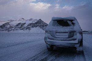 Car on Road in Snowy Landscape