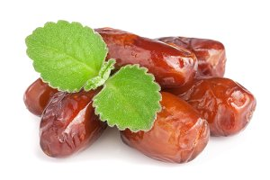 Dates with mint leaves isolated on white background