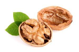 Walnut with leaf isolated on white background