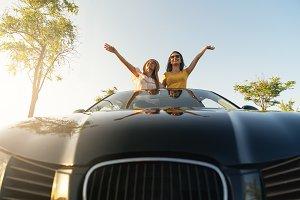 Women having fun in te car.